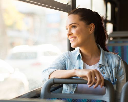 young woman-bus-happy_compressed
